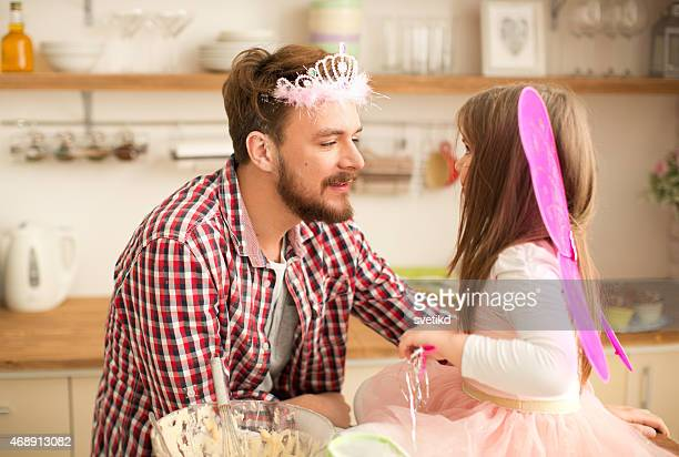 father and daughter baking in kitchen. - fathers day stock pictures, royalty-free photos & images