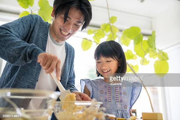 father and daughter baking together - east asian culture stock photos and pictures
