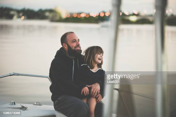 father and daughter boat trip - waterfront stock pictures, royalty-free photos & images