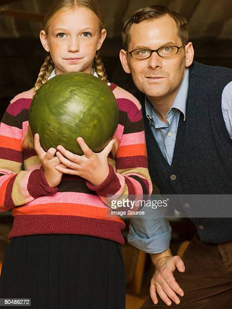 Father and daughter bowling