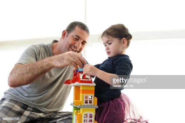 father and daughter building a home - rafael ben ari 個照片及圖片檔