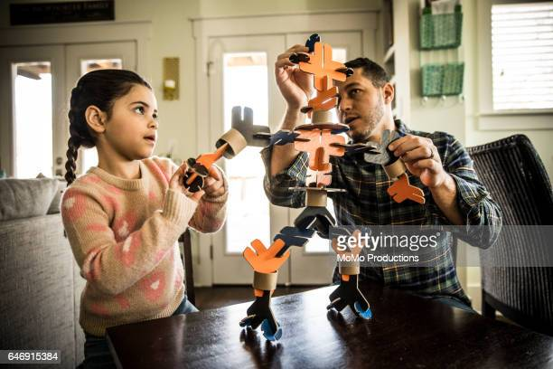 Father and daughter building robot (7 yrs)