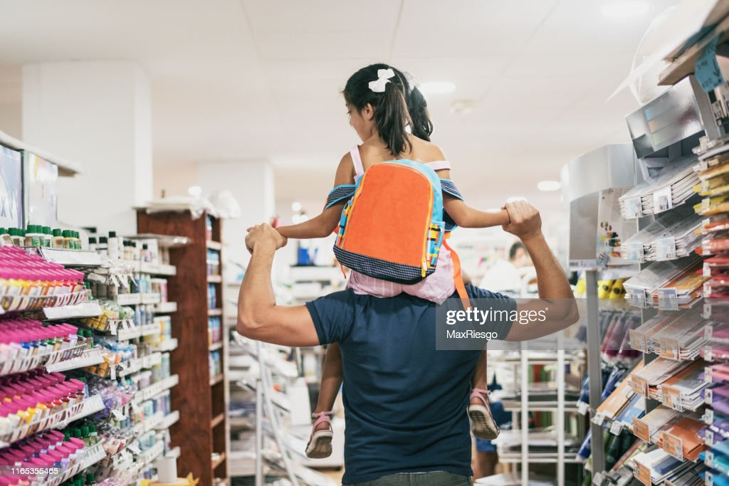 Father and daughter buying school supplies preparing to go back to school, on shoulders : Stock Photo