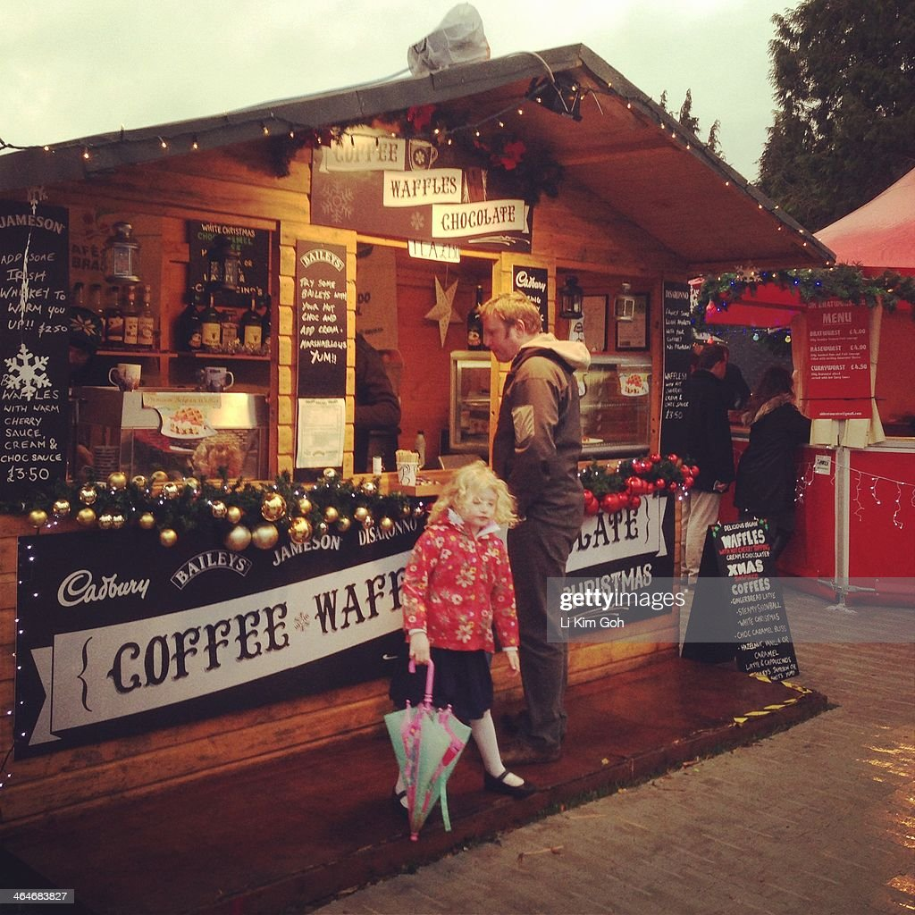 Father And Daughter Buys Hot Chocolate At Christmas Market Stall In News Photo -4412