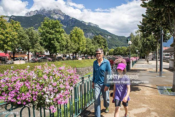 father and daughter by flowers - sallanches stock pictures, royalty-free photos & images
