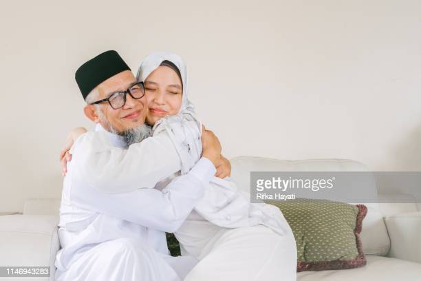 father and daughter celebrate eid mubarak together - eid ul fitr photos stock pictures, royalty-free photos & images
