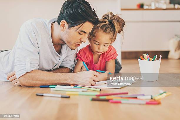 father and daughter coloring together - colouring stock pictures, royalty-free photos & images