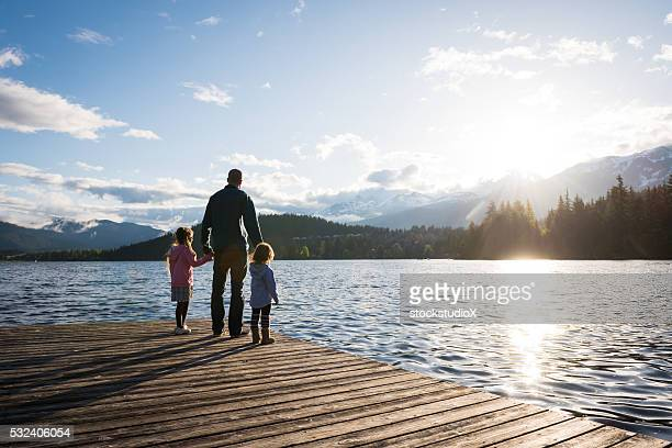 father and daughter connection - sunset lake stock photos and pictures
