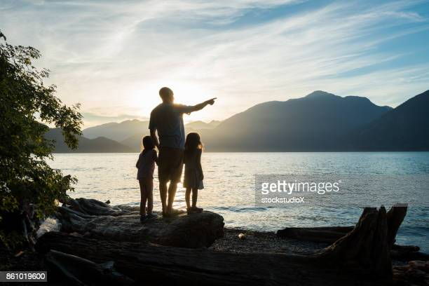 father and daughter connection - coastline stock pictures, royalty-free photos & images