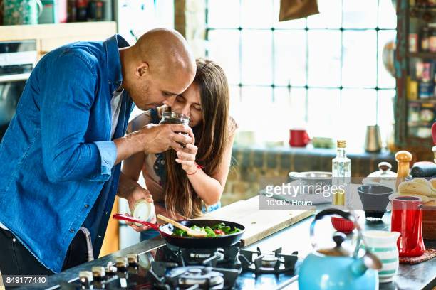 father and daughter cooking in kitchen - spice stock pictures, royalty-free photos & images