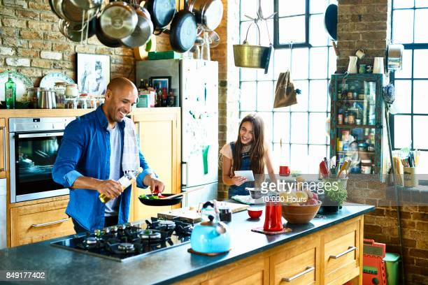 father and daughter cooking together - cooker stock pictures, royalty-free photos & images