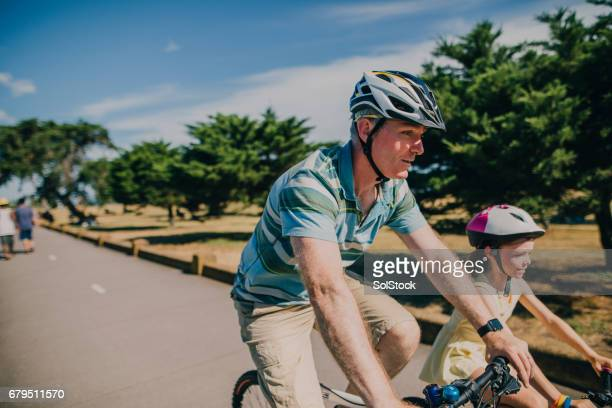 Father and Daughter Cycling in the Park
