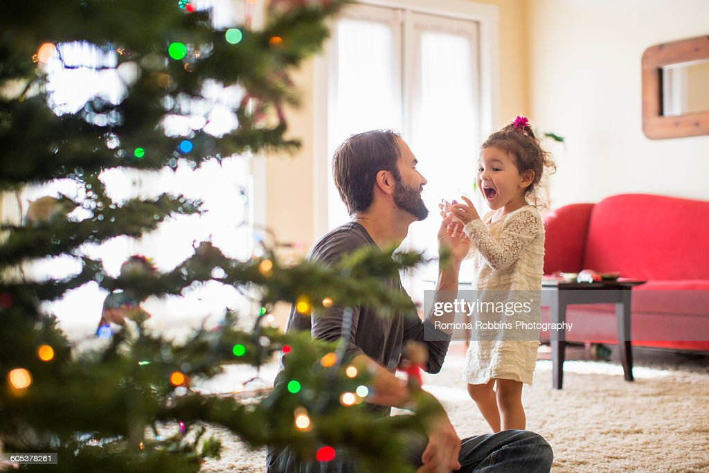 Father and daughter decorating christmas tree : Stock Photo