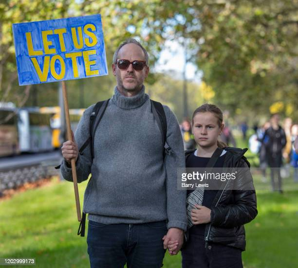 Father and daughter demonstrating for the Together for the final say march for a People¹s Vote on 19th October 2019 in London, United Kingdom. On...