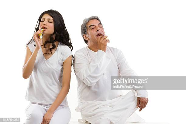 Father and daughter eating chocolate