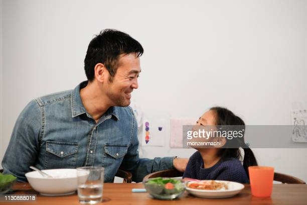 father and daughter eating curry rice together at home - curry meal stock pictures, royalty-free photos & images