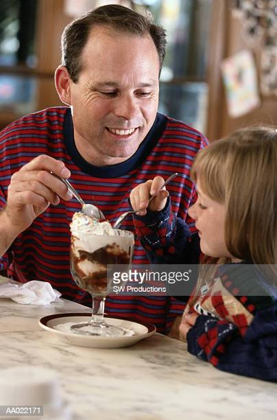 Father and Daughter Eating Ice Cream