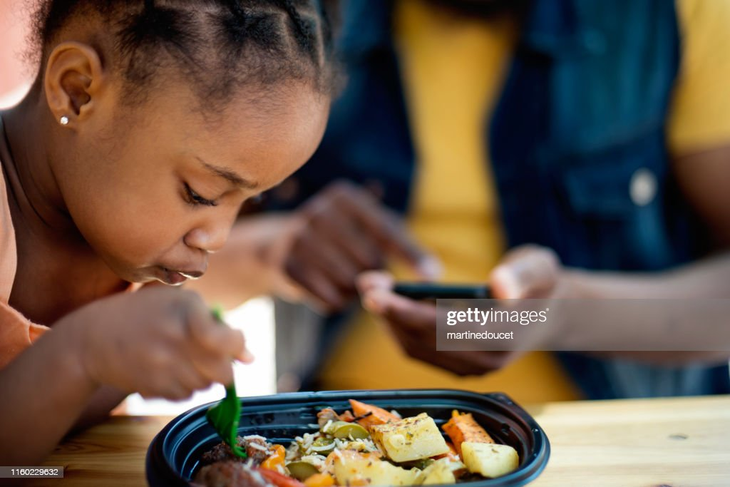 Father and daughter eating take out food outdoors. : Stock Photo