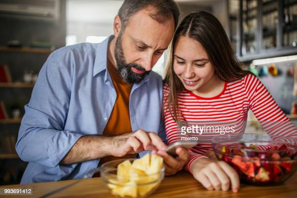 father and daughter enjoying at home - blackberry fruit stock pictures, royalty-free photos & images