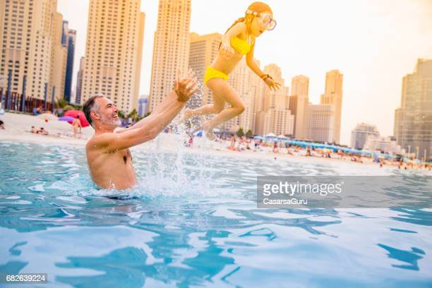 Father And Daughter Enjoying At The Dubai Beach
