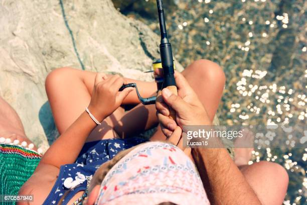 father and daughter fishing - europäischer abstammung stock pictures, royalty-free photos & images