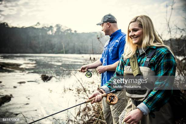Father and daughter fly-fishing