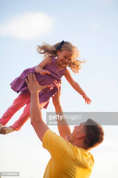 Father and daughter flying in the air