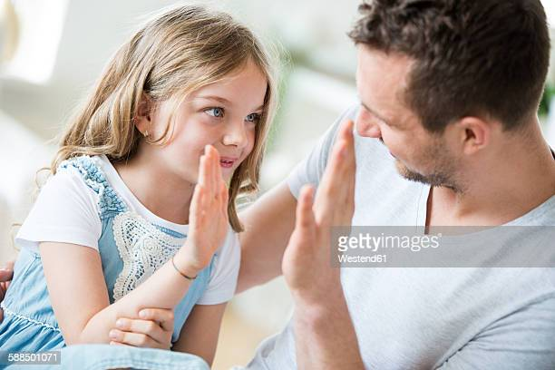Father and daughter giving high five