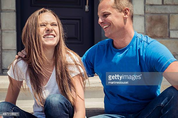 """father and daughter hanging out on the porch. - """"martine doucet"""" or martinedoucet stock pictures, royalty-free photos & images"""
