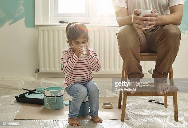 Father and Daughter having a break from decorating