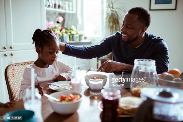 father and daughter having breakfast - modern manhood stock pictures, royalty-free photos & images