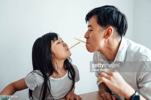 father and daughter having fun at home - genderblend stock pictures, royalty-free photos & images
