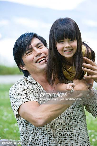 """father and daughter (4-5) having fun in park - """"compassionate eye"""" stock pictures, royalty-free photos & images"""
