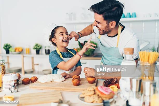 father and daughter having fun in the kitchen - fathers day stock pictures, royalty-free photos & images