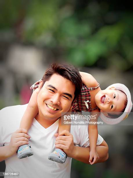 father and daughter having fun - filipino family stock pictures, royalty-free photos & images