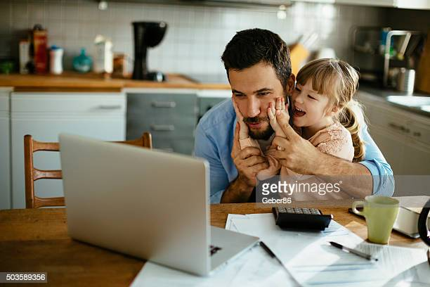 father and daughter having fun - calculator stock photos and pictures