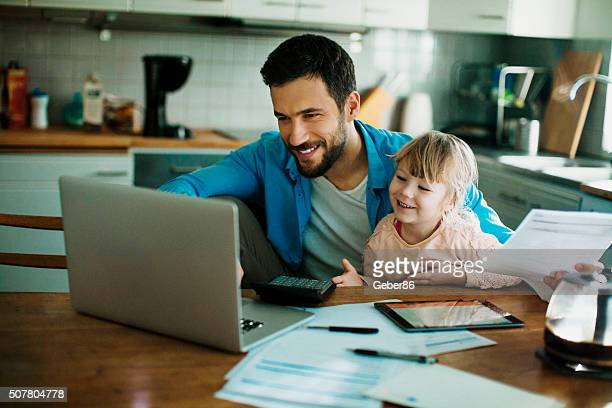 father and daughter having fun - fun calculator stock photos and pictures