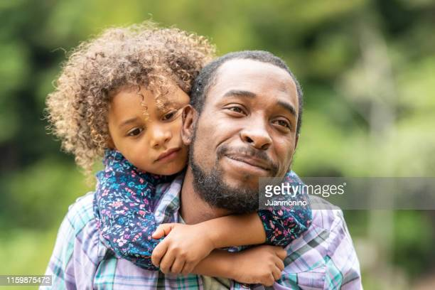 father and daughter having fun together - minority groups stock pictures, royalty-free photos & images