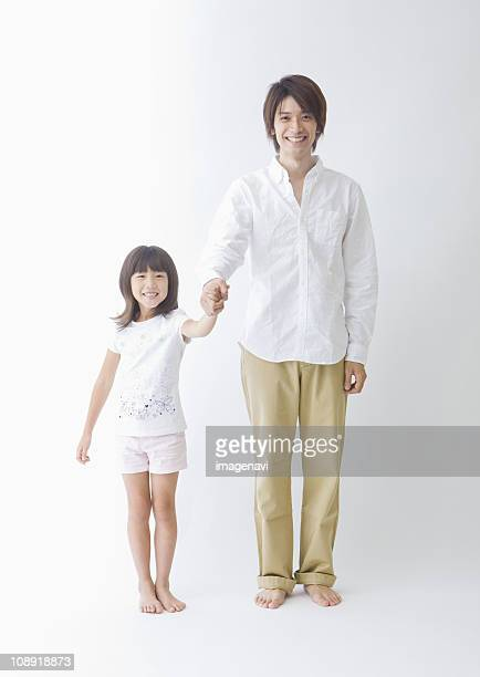Father and daughter hoding hands