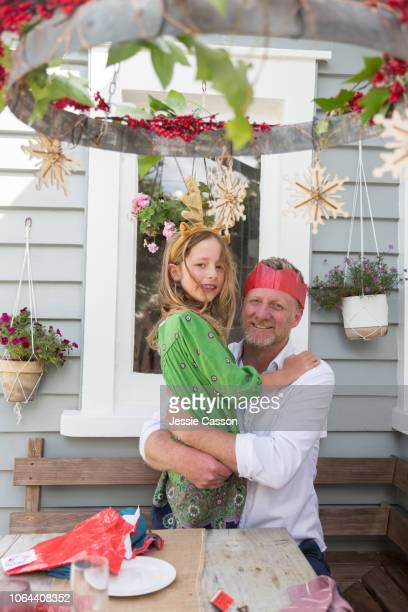 A father and daughter hug at the Christmas lunch table