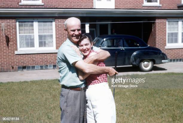 Father and daughter hug,ca 1951.