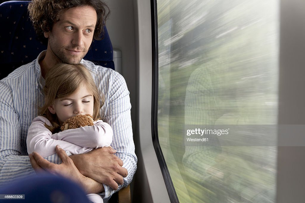 Father and daughter in a train : Stock-Foto