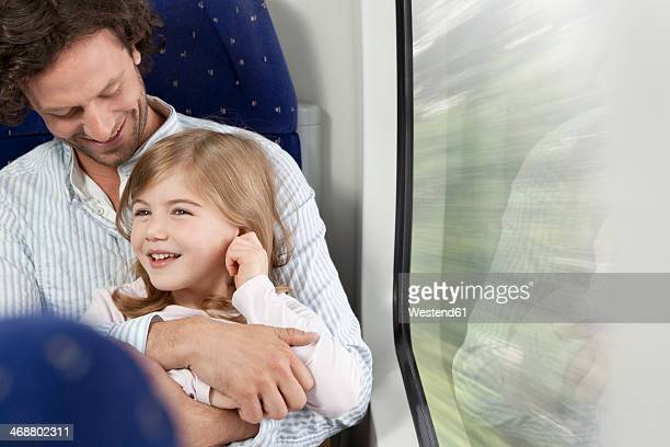 Father and daughter in a train