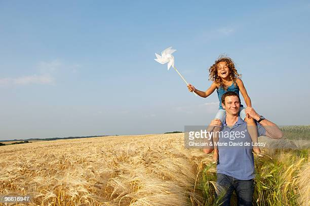 father and daughter in a wheat field - belgium stock pictures, royalty-free photos & images