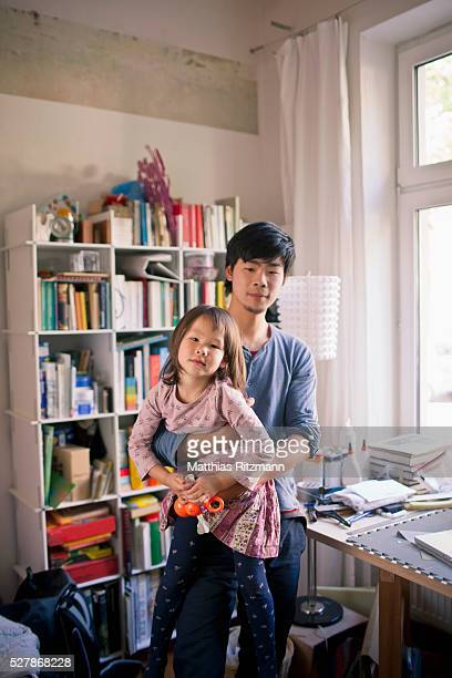 Father and daughter (5-6) in home office