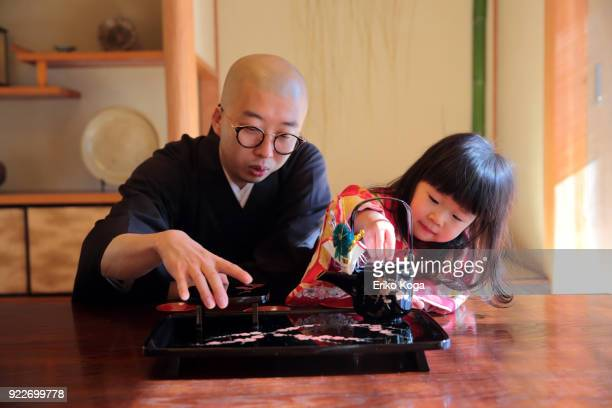 Father and daughter in kimono acting funny
