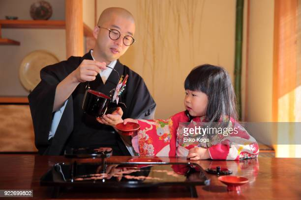 father and daughter in kimono acting funny - 僧 ストックフォトと画像