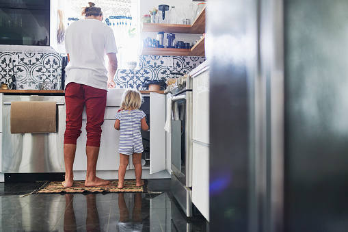 Father and daughter in kitchen at home - gettyimageskorea