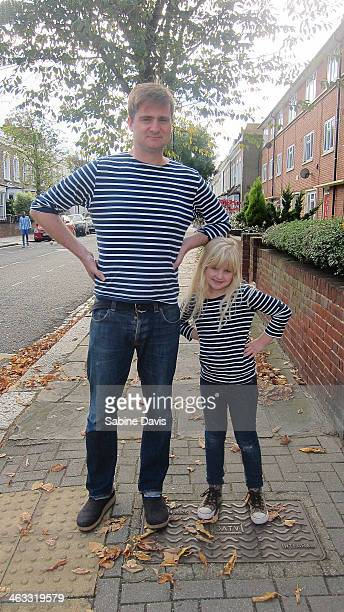 A father and daughter in matching outfits