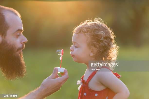 father and daughter in park - fragility stock pictures, royalty-free photos & images
